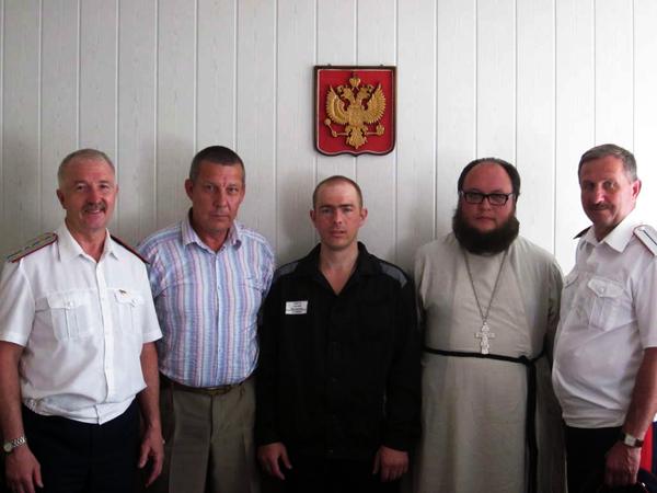 Евгений Стригин (в центре)